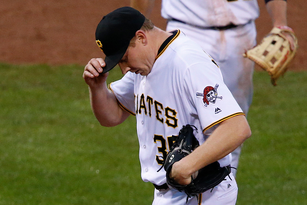 . Pittsburgh Pirates relief pitcher Mark Melancon collects himself on the mound after giving up a single to Colorado Rockies\' Tony Wolters that drove in one run and allowed another to score on an error on Pirates first baseman John Jaso in the ninth inning of a baseball game in Pittsburgh, Saturday, May 21, 2016. The Rockies won 5-1. (AP Photo/Gene J. Puskar)