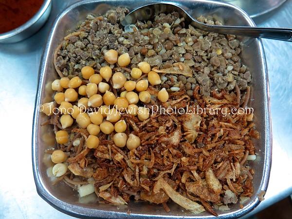 "EGYPT, Cairo. ""Koshary"" meal (lentils, pasta, rice, chickpeas, garlic mix) (2.2016)"