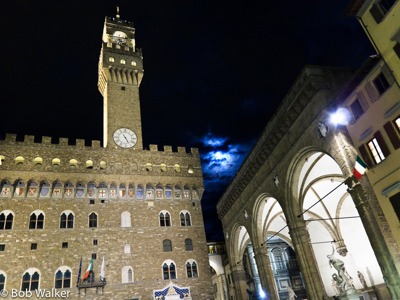 """Palazzo Vecchio (""""Old Palace"""") is the town hall of Florence. http://en.wikipedia.org/wiki/Palazzo_Vecchio Moon peeking through clouds between the buildings"""