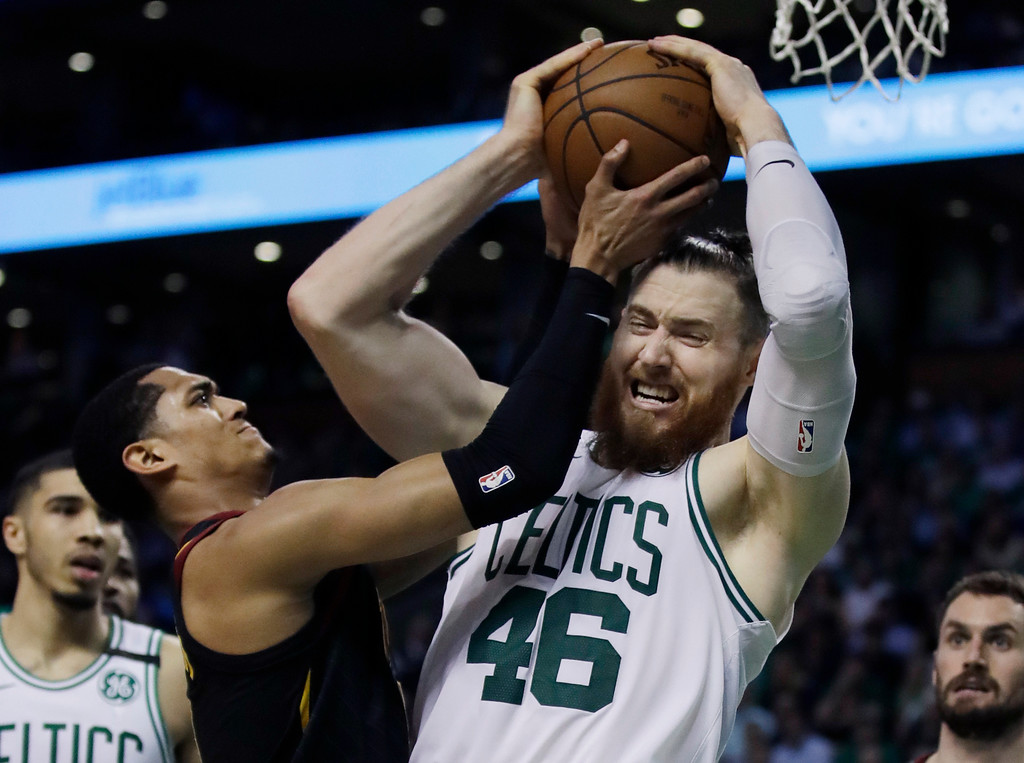 . Boston Celtics center Aron Baynes (46) competes for a rebound against Cleveland Cavaliers guard Jordan Clarkson during the second quarter of Game 5 of the NBA basketball Eastern Conference finals Wednesday, May 23, 2018, in Boston. (AP Photo/Charles Krupa)