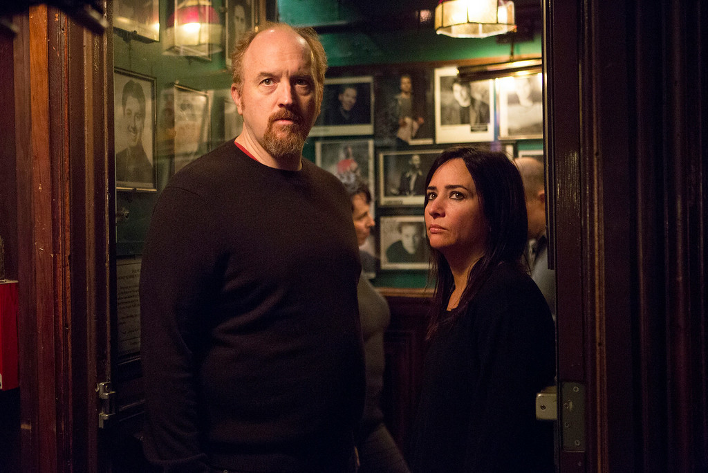 """. This image released by FX shows Louis C.K. as Louie, left, and Pamela Adlon as Pamela in a scene from \""""Louie.\"""" Louis C.K. was nominated for an Emmy Award for best actor in a comedy on Thursday, July 10, 2014. The 66th Primetime Emmy Awards will be presented Aug. 25 at the Nokia Theatre in Los Angeles.  (AP Photo/FX, KC Bailey)"""