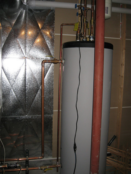 New water heater. Operates off of new boiler which also heats floors.
