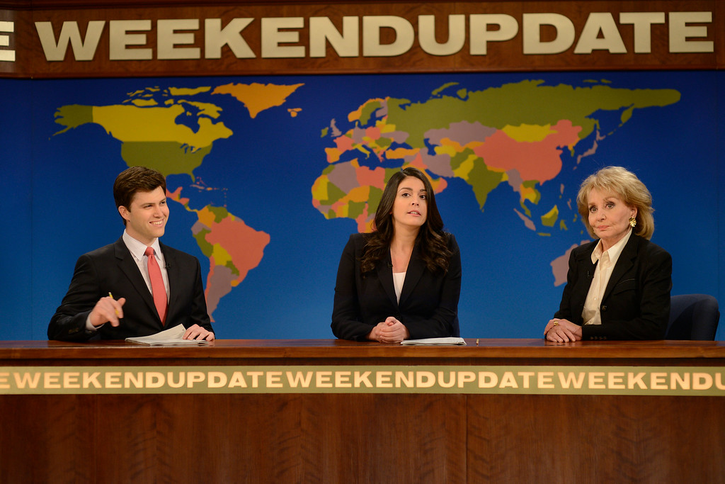 ". This May 10, 2014 photo released by NBC shows cast members Colin Jost, left, and Cecily Strong, center, with TV personality Barbara Walters who made an appearance on the Weekend Update segment of ""Saturday Night Live,\"" in New York. On Friday, May 16, 2014, capping a spectacular half-century run she began as the so-called \""Today\"" Girl, Walters will exit ABC\'s \""The View.\"" Behind the scenes she will remain as an executive producer of the New York-based talk show she created 17 years ago, and make ABC News appearances as events warrant and stories catch her interest. Walters has often been parodied on the weekly sketch comedy series. (AP Photo/NBC, Dana Edelson)"