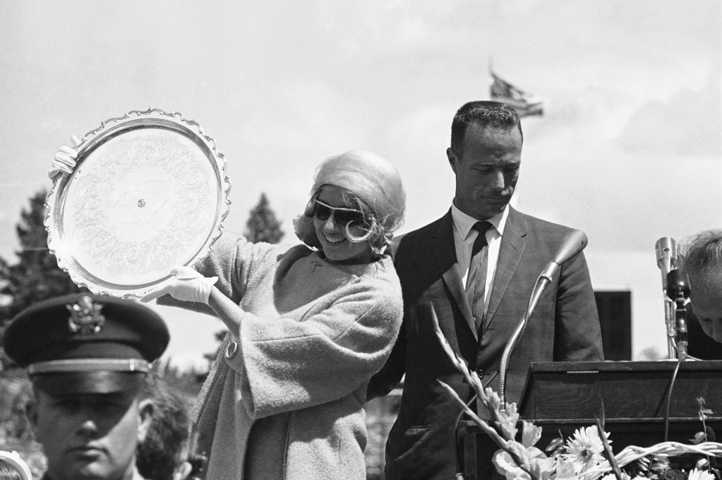 . Mrs. Renee Carpenter, wife of the astronaut, holds up the silver tray presented to Scott Carpenter in Boulder, Colorado on May 29, 1962 as a gift from his home state of Colorado. The astronaut is being feted for three days by Coloradoans. (AP Photo)