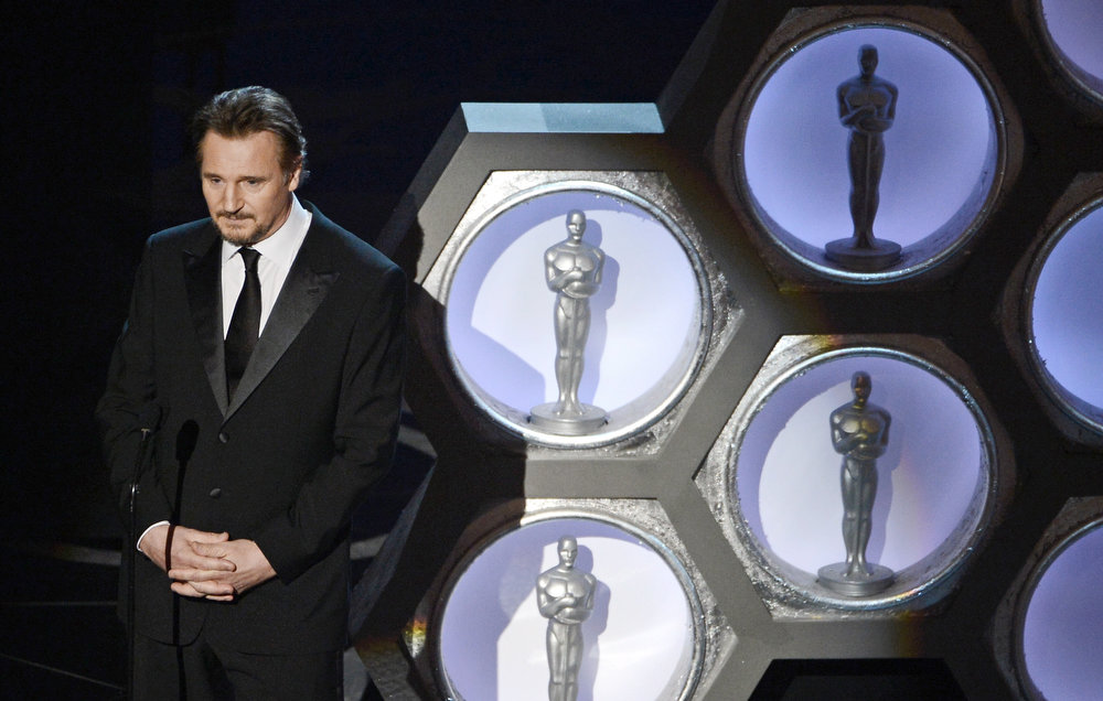 Description of . Actor Liam Neeson presents onstage during the Oscars held at the Dolby Theatre on February 24, 2013 in Hollywood, California.  (Photo by Kevin Winter/Getty Images)