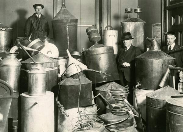 . State Prohibition agents stand amid 89 confiscated moonshine stills, valued at $10,000 by law enforcement, in December 1920. (Denver Post digital archive photo)
