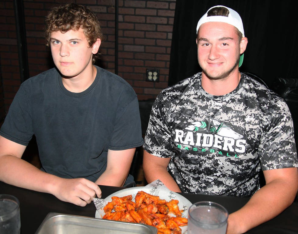 . Columbia\'s Nick Stopiak (left) and Nick Millazzi pause just before the beginning of Tuesday\'s wing eating contest at the Hooley House. They would finish in first as well.