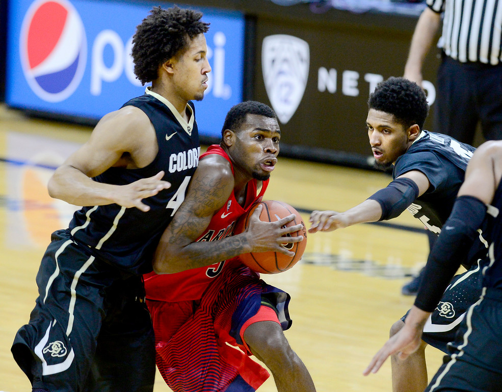 . Arizona guard Kadeem Allen drives on Colorado\'s Josh Fortune, left, and Dominique Collier during the first half of an NCAA college basketball game Wednesday, Feb. 24, 2016, in Boulder, Coio. (AP Photo/Cliff Grassmick)