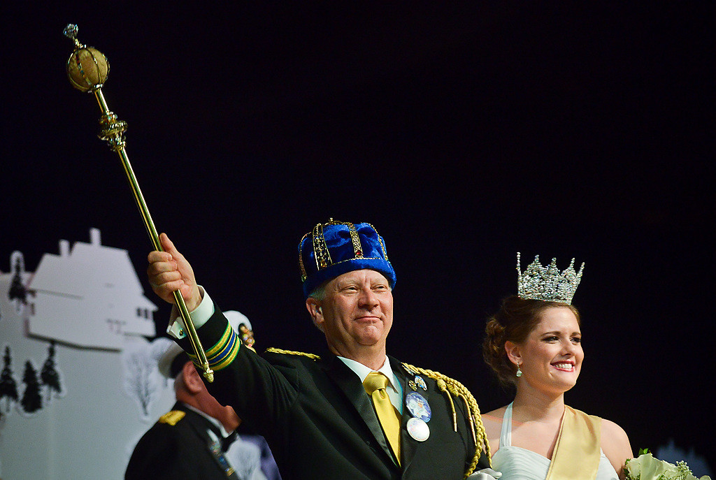 . Roger C. Kruse of Anoka, this year\'s King Boreas LXXVIII, salutes the crowd with the new 2014 Queen of the Snows Abby Hoglin of Lakeville. (Pioneer Press: Ben Garvin)