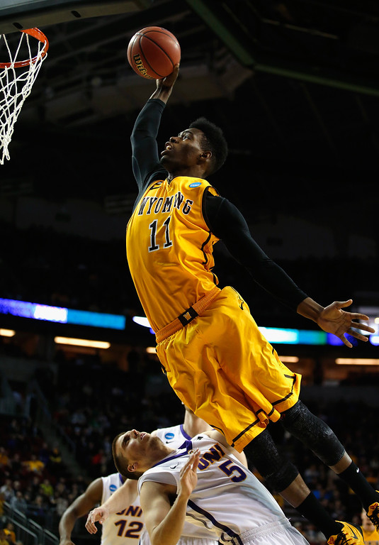 . Derek Cooke Jr. #11 of the Wyoming Cowboys jumps to take a shot over Matt Bohannon #5 of the Northern Iowa Panthers during the first half of their game in the second round of the 2015 Men\'s NCAA Basketball Tournament at KeyArena on March 20, 2015 in Seattle, Washington.  (Photo by Ezra Shaw/Getty Images)