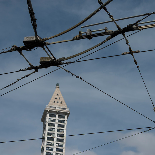 High-tension wires in front of a tower, Smith Tower, Pioneer Square, Seattle, Washington State, USA