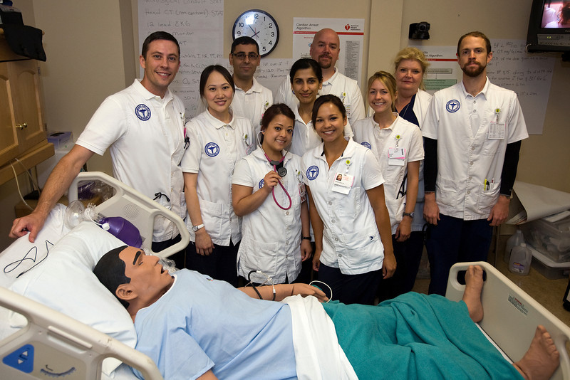 Sacramento City College Extended Campus nursing students in the patient simulation lab.  From left: Brian Bangs, Blia Vang, Hayat Niazi, Maiyen Tran, Manpreet Kaur, Rebecca Peirce, Natasha Maier, instructor Jill Clary and Justin Seither.