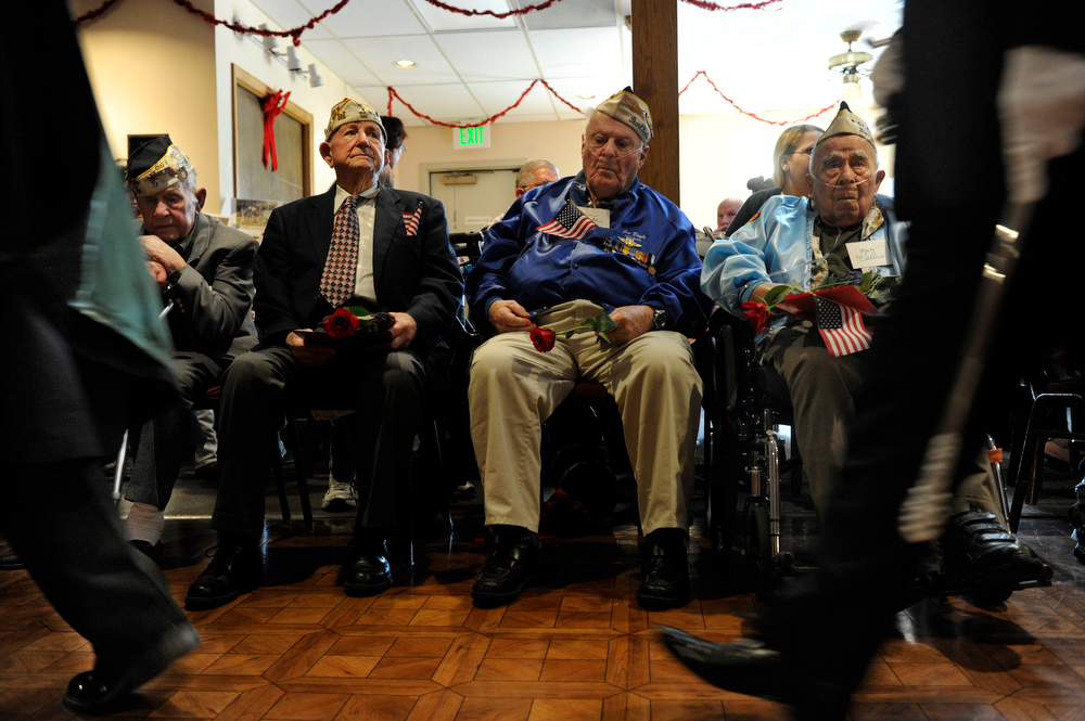 . Pearl Harbor veterans from left to right George Richard, Dave Wilson, Jim Doyle, and Luz Valerio watch as the Knights of Columbus color guard passes by. The American Legion Post 1 in Denver hosts a Remember Pearl Harbor 71st Anniversary Program on Friday, Dec. 7, 2012, honoring the survivors, their wives, and the widows. Kathryn Scott Osler, The Denver Post