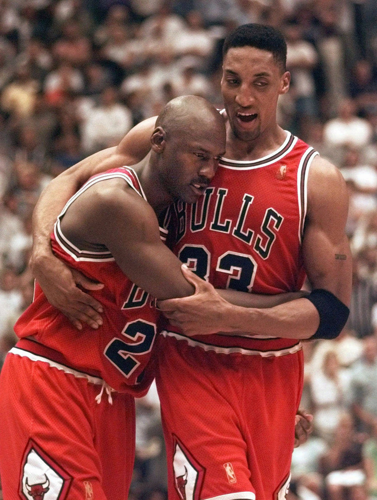 Description of . The Chicago Bulls' Michael Jordan collapses in the arms of teammate Scottie Pippen, right, at the end of Game 5 of the NBA Finals with the Utah Jazz in Salt Lake City, in this June 11, 1997 photo.  Jordan, fighting flu symptoms, scored 38 points as the Bulls beat the Jazz 90-88 to take a 3-2 lead in the series.  Jordan,  the greatest player in NBA history and the most popular athlete since Muhammad Ali is expected to announce his retirement Wednesday  at a news conference in Chicago, a source with close ties to the NBA told The Associated Press on Monday night Jan. 11, 1999.  (AP Photo/Susan Ragan)