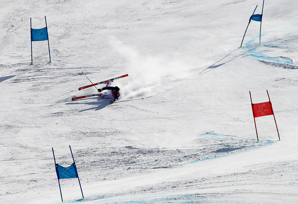 . South Korea\'s Jung Donghyun crashes during the first run of the men\'s giant slalom at the 2018 Winter Olympics in Pyeongchang, South Korea, Sunday, Feb. 18, 2018. (AP Photo/Christophe Ena)