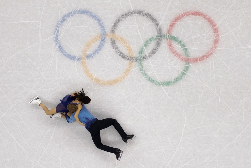 . Madison Chock and Evan Bates of the United States fall during the ice dance, free dance figure skating final in the Gangneung Ice Arena at the 2018 Winter Olympics in Gangneung, South Korea, Tuesday, Feb. 20, 2018. (AP Photo/Morry Gash)