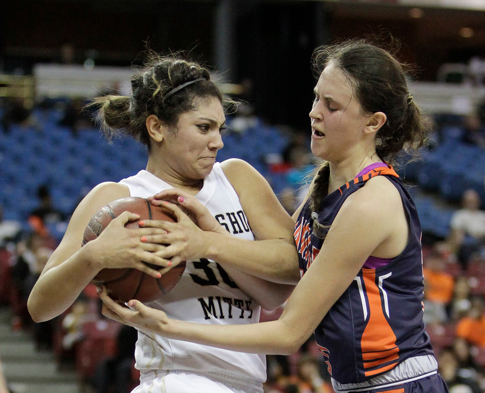 . Archbishop Mitty guard Taylor Todd, left, pulls the ball away from Chaminade forward Natalie Valenzuela during the second half of the girls\' Division 2 CIF basketball championship game Saturday, March 29, 2014, in Sacramento, Calif. Chaminade won 85-51. (AP Photo/Rich Pedroncelli)