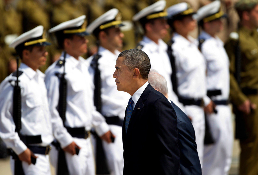 . US President Barack Obama reviews an honor guard upon his arrival at Ben Gurion airport near Tel Aviv, Israel, Wednesday, March 20, 2013. (AP Photo/Ariel Schalit)
