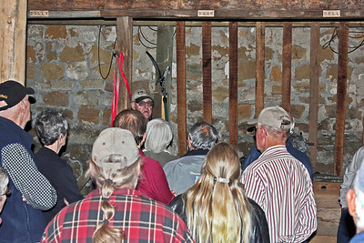 While a bit of the large Anderson barn has been restored, much remains to be done.  That's James and Catherine Anderson's great grandson, Hank Frawley (facing camera in the back), sharing information about the barn.