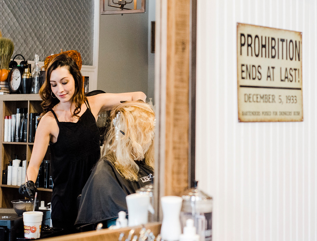 . Stylist Michelle Evans works on a client at Salon Speakeasy, located in downtown Leominster, on Wednesday, October 4, 2017. SENTINEL & ENTERPRISE / Ashley Green