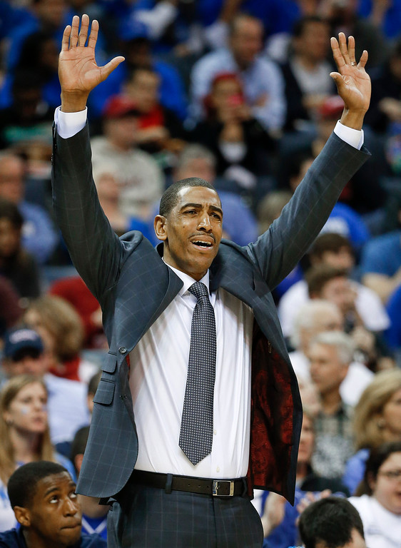 . Connecticut coach Kevin Ollie gestures to his players during the first half of an NCAA college basketball game against Memphis in the quarterfinals of the American Athletic Conference men\'s tournament Thursday, March 13, 2014, in Memphis, Tenn. (AP Photo/Mark Humphrey)