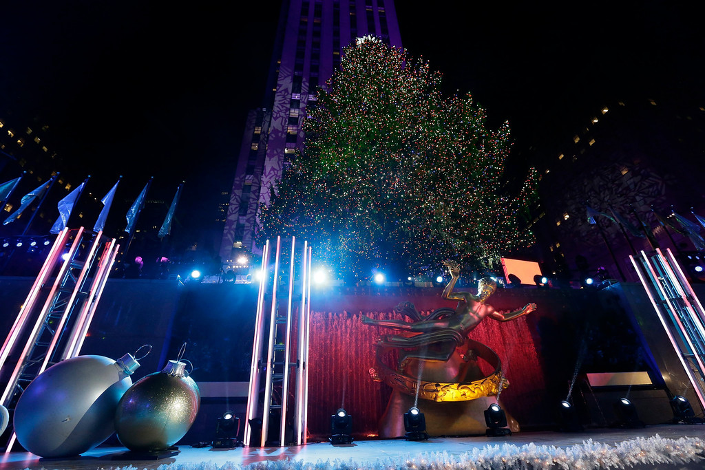 . epa03976994 The Rockefeller Center Christmas tree stands lit during the 81st annual lighting ceremony in New York, New York, USA, 04 December 2013. 45,000 energy efficient LED lights we\'re installed on the 76-foot--tall tree,  plus other decorations. The Rockefeller Center Christmas tree is a New York institution and was started in 1933.  EPA/JASON SZENES