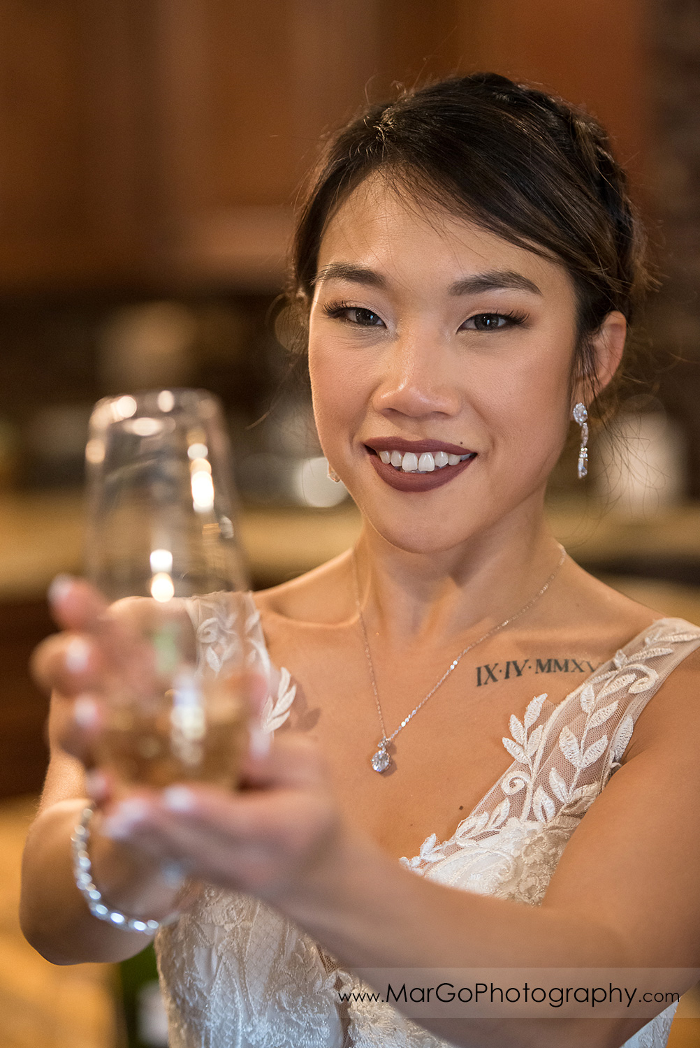 bride with champagne glass at Sunol's Casa Bella bridal suite