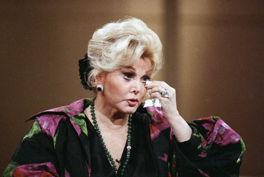 . Actress Zsa Zsa Gabor touches a tissue to her eye during an appearance on the  Donahue Show on Oct. 27, 1989 in New York.   Gabor recounted her arrest on television and recent conviction on an assault charge for slapping a Beverly Hills, Calif., police officer. (AP Photo/Mark Lennihan)