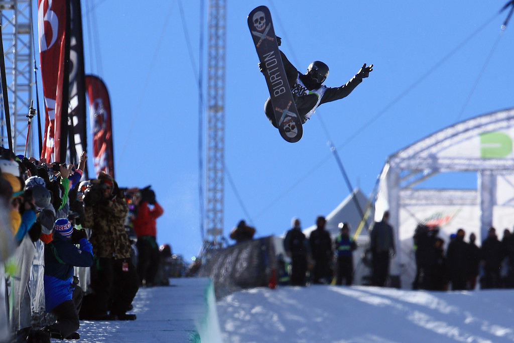 . Shaun White in action during his second run as he finished second in the men\'s snowboard superpipe final at the Dew Tour iON Mountain Championships on December 14, 2013 in Breckenridge, Colorado.  (Photo by Doug Pensinger/Getty Images)