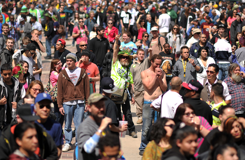 . DENVER, CO. - APRIL 20 : A crowd of marijuana smokers gathered at Civic Center Park in Denver to mark the counterculture holiday known as 4/20 on the first celebration since Colorado and Washington made pot legal for recreation use. (Photo By Hyoung Chang/The Denver Post)