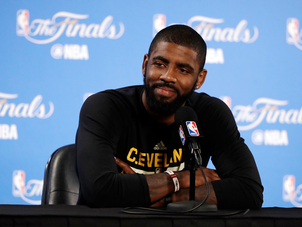 . Cleveland Cavaliers\' Kyrie Irving smiles as he fields questions before an NBA basketball practice, Wednesday, May 31, 2017, in Oakland, Calif. The Cavaliers face the Golden State Warriors in Game 1 of the NBA Finals on Thursday in Oakland. (AP Photo/Marcio Jose Sanchez)