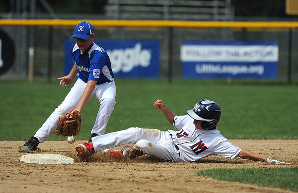 8/6/2018 Mike Orazzi | Staff' Mid Island New York's Chris Cancel (13) slides into second as Keystone's Kevin Grenninger (25) takes the throw during the 2018 Little League Eastern Regional Tournament at Breen Field in Bristol Monday morning.