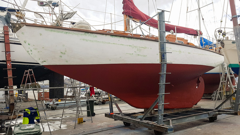 Top coat of red anti-foul done , topsides filler and ready to sand.