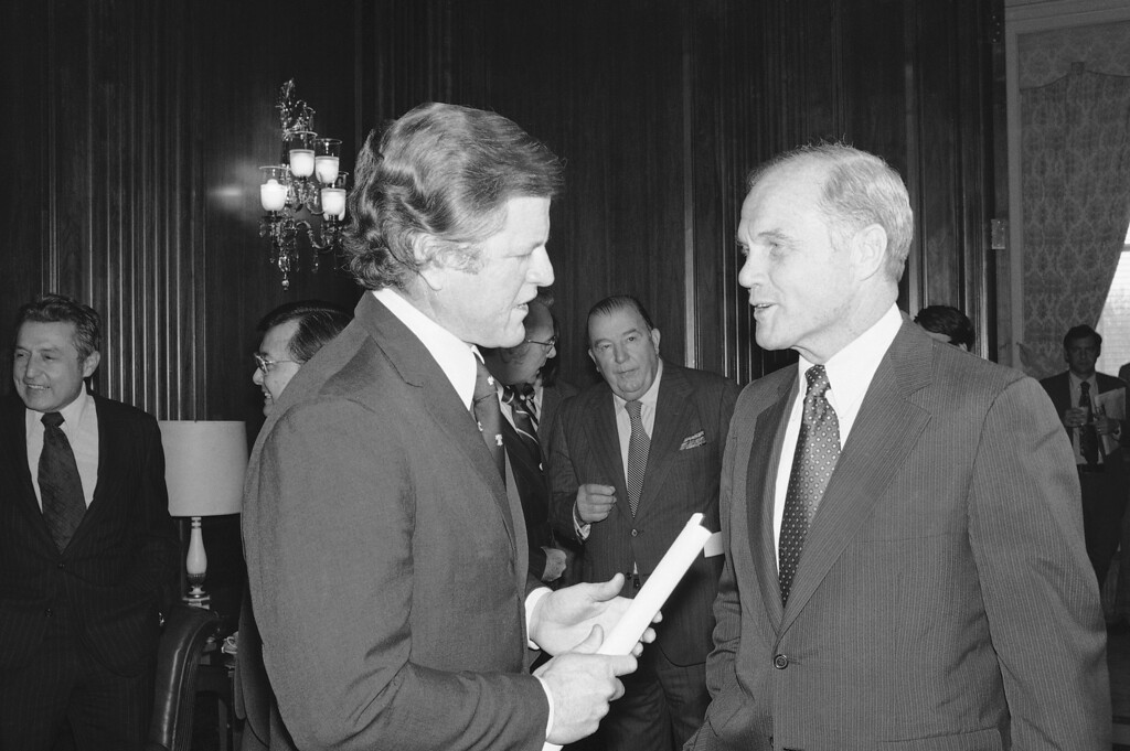 . Sen. Edward Kennedy, D-Mass., and John Glenn, D-Ohio, exchange ideas during a chat on Capitol Hill in Washington on Jan. 14, 1975. (AP Photo)