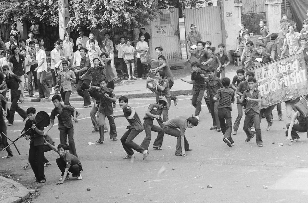 . Rock throwing Saigon middle school students charge police during an anti-draft demonstration in Saigon, Thursday, March 27, 1975. The students were angered by changes in the conscription law, lowering the draft age to 17. The change came about due to the increasingly serious military situation. (AP Photo/Lo Vinh)