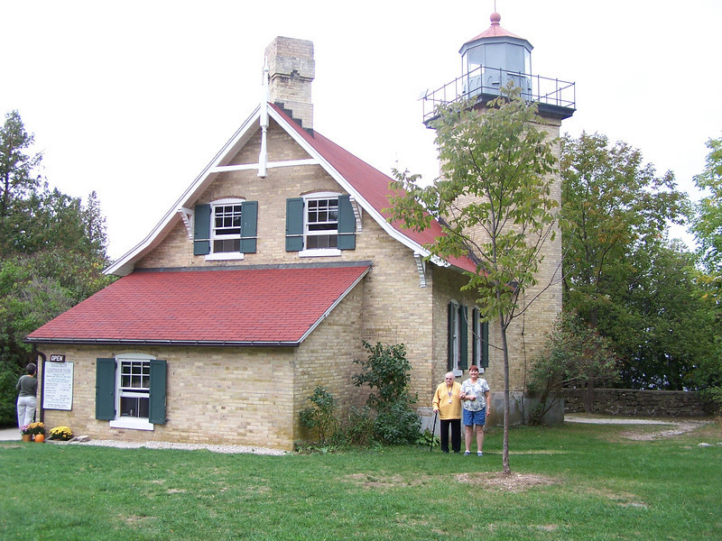 Eagle Bluff Lighthouse was built in 1868 to guide ships through one of the two shipping channels between the city of Green Bay and points north and east. This east channel is narrow and treacherous with the park bluffs on one side and the large, flat shoals of the Strawberry Islands on the other. The second channel, west of Chambers Island, lies several miles west of the Wisconsin shore. A lighthouse almost identical to Eagle Bluff's was built on Chambers Island in the same year, to guide ships using the west channel.
