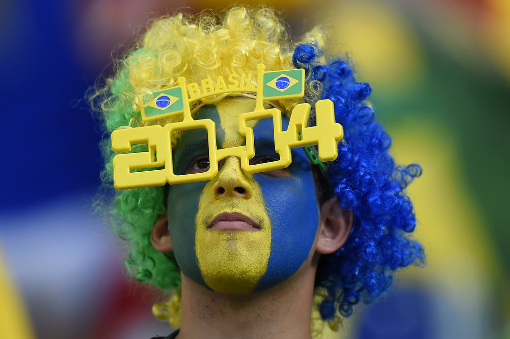 . A Brazil\'s supporter cheers prior to the quarter-final football match between Brazil and Colombia at the Castelao Stadium in Fortaleza during the 2014 FIFA World Cup on July 4, 2014. FABRICE COFFRINI/AFP/Getty Images