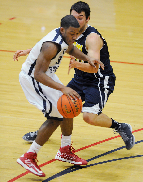 . DENVER, CO. - MARCH 5: Roadrunners guard Brandon Jefferson, left, made a move around Cougars defender Kyle Weaver, right, in the first half. The Metro State University of Denver men\'s basketball team defeated Colorado Christian University 87-75 Tuesday night, March 5, 2013. (Photo By Karl Gehring/The Denver Post)