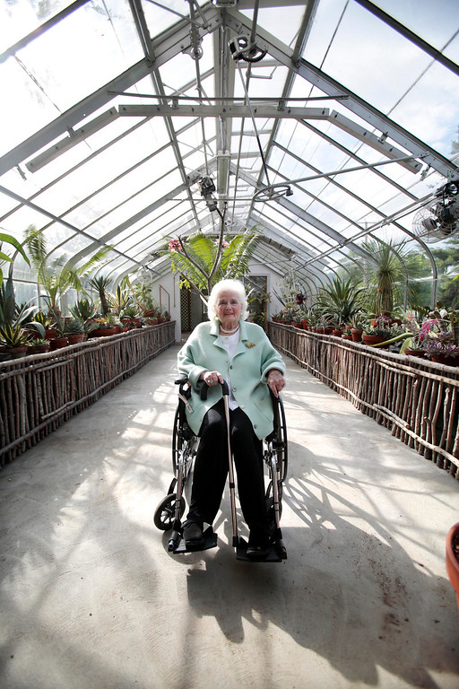 . Jane Fitzpatrick poses for a portrait in the greenhouse that bears her name at a garden party in honor of the dedication of the Berkshire Botanical Garden\'s newest addition, the Fitzpatrick Greenhouse in Stockbridge. Friday, June 28, 2013. Stephanie Zollshan/Berkshire Eagle.