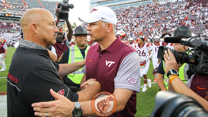 Virginia Tech head coach Justin Fuente (right) shakes hands with Boston College head coach Steve Adazzio (left) after the final whistle. Virginia Tech shut out Boston College 49-0. (Mark Umansky/TheKeyPlay.com)