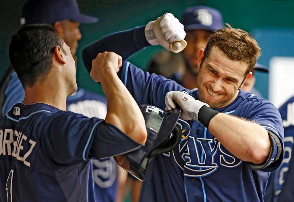 . Tampa Bay\'s Evan Longoria, right, celebrates with teammate Sean Rodriguez after hitting a solo home run during the sixth inning against the Twins. (AP Photo/Mike Carlson)