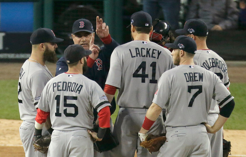 . Boston Red Sox manager John Farrell calls for Craig Breslow to take over for John Lackey (41) in the seventh inning during Game 3 of the American League baseball championship series against the Detroit Tigers  Tuesday, Oct. 15, 2013, in Detroit. (AP Photo/Charlie Riedel)