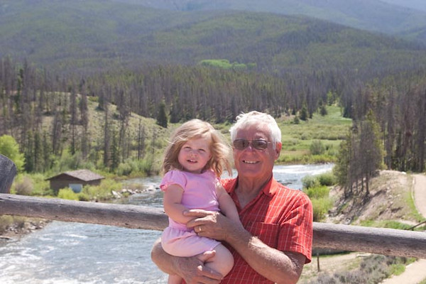 Rocky Mountain National Park in background, Alie and her happy granddad, foreground.
