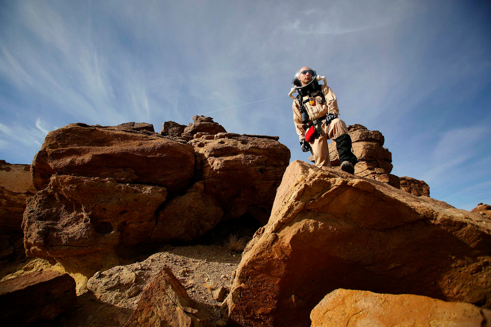 . Hans van Ot Woud, a mapping researcher and the health and safety officer of Crew 125 EuroMoonMars B mission, collects geologic samples for study at the Mars Desert Research Station (MDRS) outside Hanksville in the Utah desert March 2, 2013.  REUTERS/Jim Urquhart