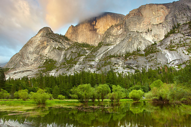Last light on Half Dome. The warm light filled the entire cliffside giving off a reddish-orange glow. There was nobody here at mirror  lake at this moment. I could not believe that I had this view all to myself.