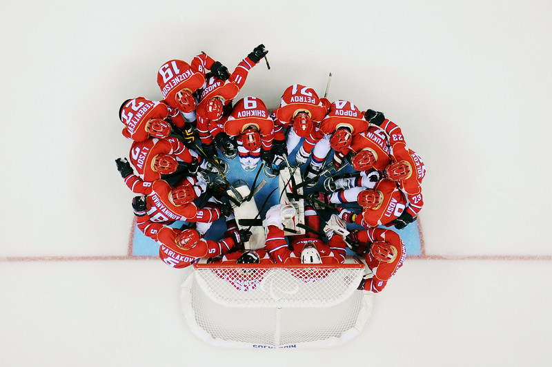 . The Russian players huddle before their Ice Sledge Hockey Preliminary Round Group A match against Korea at Shayba Arena on March 8, 2014 in Sochi, Russia.  (Photo by Dennis Grombkowski/Getty Images)