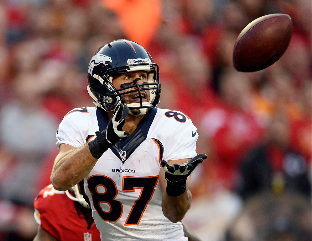 . Denver Broncos wide receiver Eric Decker (87) catches a touchdown pass from Peyton Manning during the second quarter against the Kansas City Chiefs  December 1, 2013 at Arrowhead Stadium.  (Photo by John Leyba/The Denver Post)