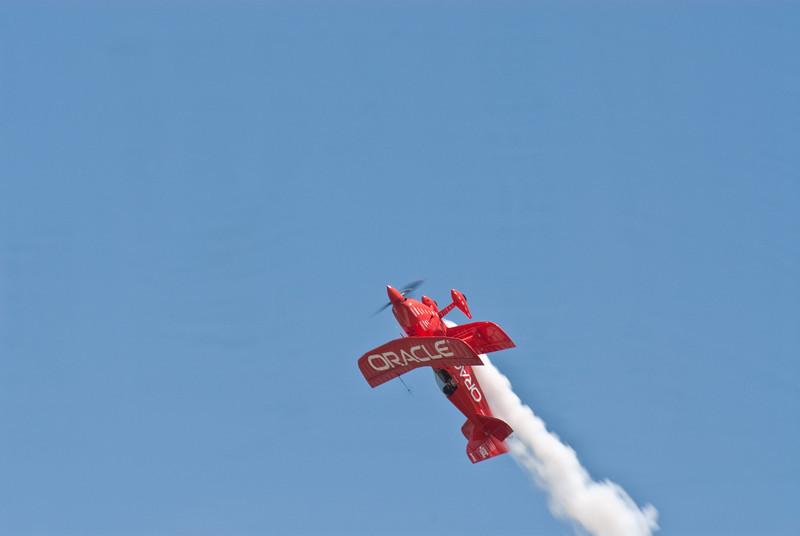 Sean Tucker flies inverted in his Oracle Challenger
