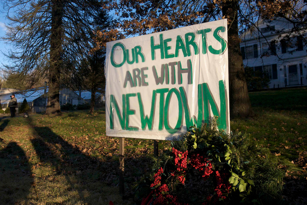 Description of . A sign is hung up across the street from the funeral home during the wake of school principal Dawn Hochsprung, a victim in the Sandy Hook Elementary School shooting, in Woodbury, Connecticut, December 19, 2012. Six more victims of the Newtown school shooting will be honored at funerals and remembrances on Wednesday, including the school principal who was killed with 20 of her students and five other staff members at the Sandy Hook Elementary School. REUTERS/ Michelle McLoughlin