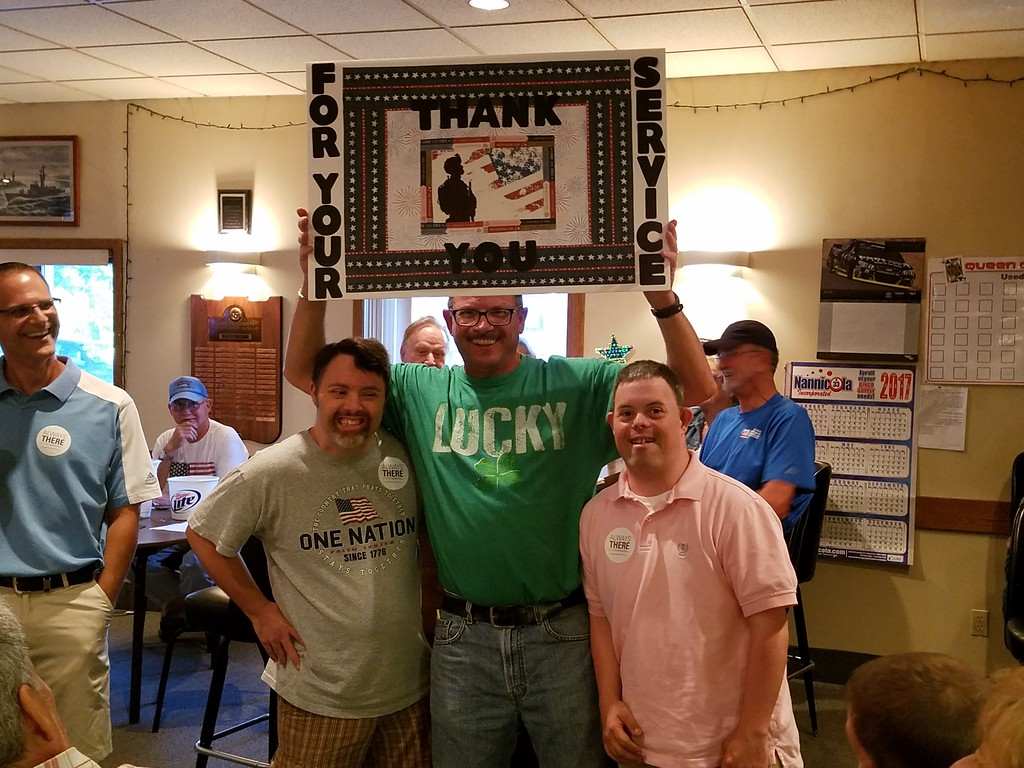 . Submitted <br> Tim Sarver and Charlie Schulz from CES at American Legion Post presenting veterans with posters and cards.